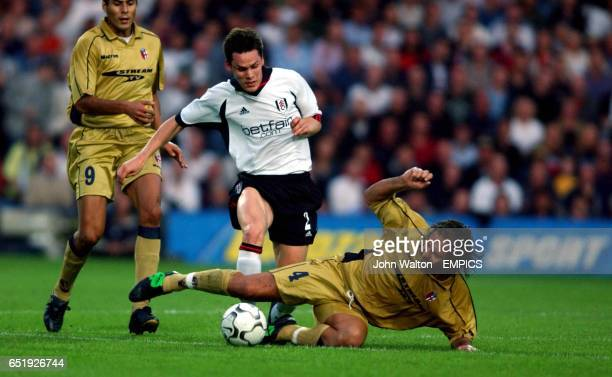 Fulham's Steve Finnan is tackled by Bologna's Renato Olive