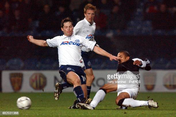 Fulham's Steve Marlet challenges Hertha Berlin's Pal Dardai for the ball