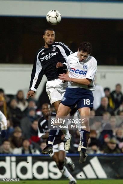 Fulham's Steve Marlet outjumps Hertha Berlin's Pal Dardai during their 3rd round 2nd leg UEFA Cup match at Loftus Road West London THIS PICTURE CAN...