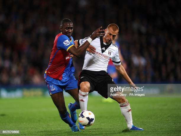 Fulham's Steve Sidwell and Crystal Palace's Yannick Bolasie battle for the ball