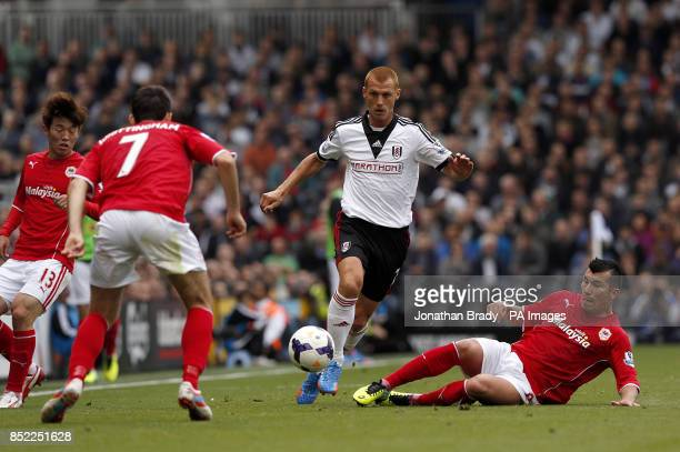 Fulham's Steve Sidwell battles for the ball with Cardiff City's Gary Medel and Peter Whittingham