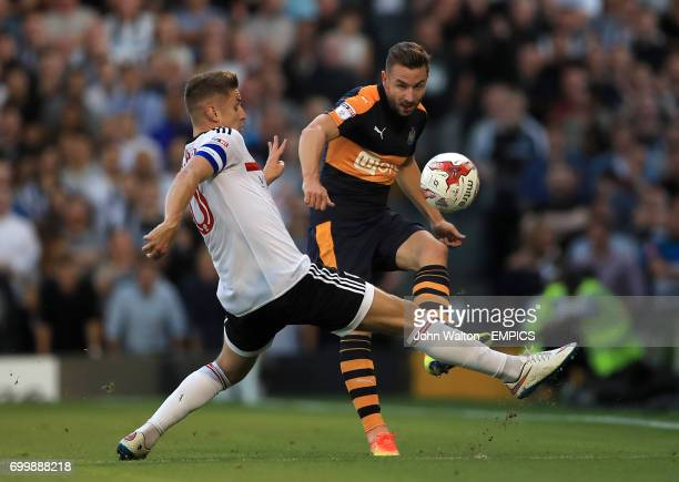 Fulham's Tom Cairney and Newcastle United's Paul Dummett in action