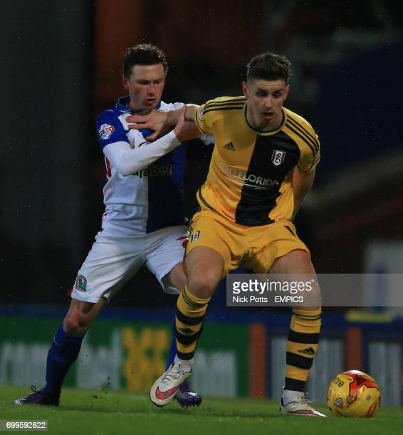 Fulham's Tom Cairney holds off Blackburn Rovers' Corry Evans
