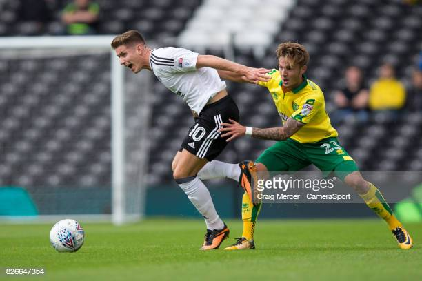 Fulham's Tom Cairney is fouled by Norwich City's James Maddison during the Sky Bet Championship match between Fulham and Norwich City at Craven...