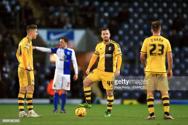 Fulham's Tom Cairney Ross McCormack and Jamie O'Hara stand dejected after conceding the third goal