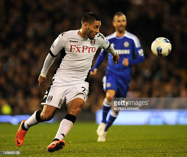 Fulham's US midfielder Clint Dempsey chases the ball during the English Premier League football match between Fulham and Chelsea at Craven Cottage in...
