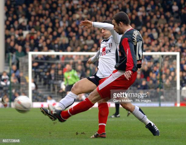 Fulham's Vincenzo Montella and Stoke City's Danny Higginbotham during the FA Cup fourth round at Craven Cottage London