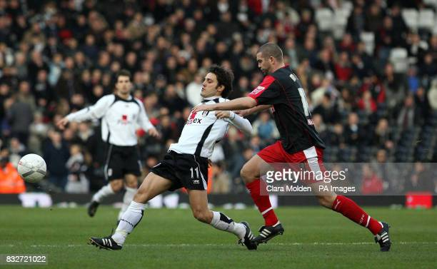 Fulham's Vincenzo Montella and Stoke City's Dominic Matteo during the FA Cup fourth round at Craven Cottage London