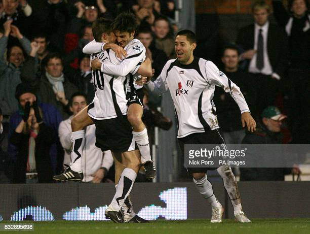 Fulham's Vincenzo Montella celebrates with team mates Clint Dempsey and Brian McBride after scoring the first goal of the match