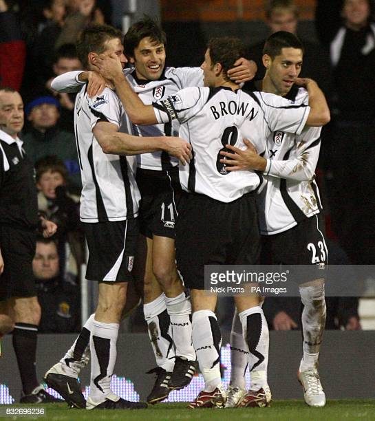 Fulham's Vincenzo Montella celebrates with team mates Clint Dempsey Brian McBride and Michael Brown after scoring the first goal of the match