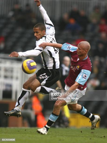 Fulham's Wayne Routledge and West Ham United's Paul Konchesky battle for the ball