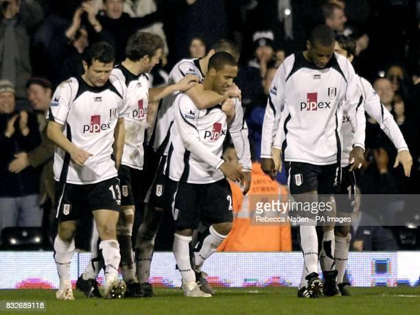 Fulham's Wayne Routledge celebrates his winning goal with team mates