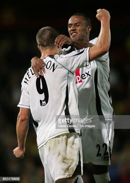Fulham's Wayne Routledge celebrates with Heidar Helguson