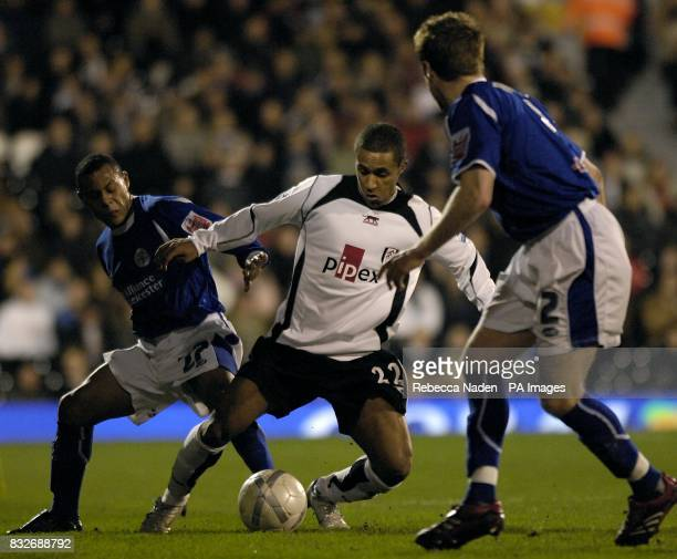 Fulham's Wayne Routledge is surrounded by Leicester City's Levi Porter and Alan Maybury