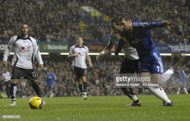 Fulham's Wayne Routledge looks on as Liam Rosenior Fulham and Andriy Shevchenko Chelsea battle for the ball