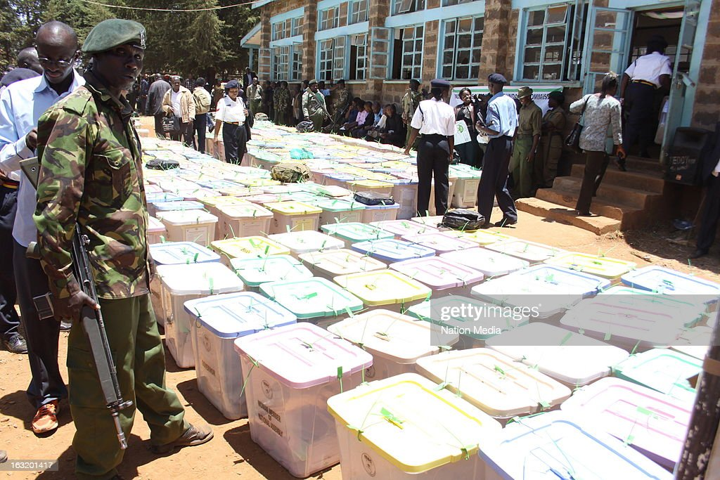 Full ballot boxes are laid out under police guard prior to counting after being returned from polling stations on March 5, 2013 at Uasin Gishu Primary School Tallying Centre in Gishu, Kenya. Kenya's last General elections resulted in mass violence across the country. Violence has been reported in 2013 elections in Mombasa with four policeman killed. This is the first General Election under the new constitution enacted in 2010.