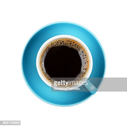 Full black coffee in blue cup close up isolated : Stock Photo