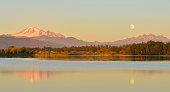 Full Blue Moon over Mt. Baker and Three Sisters Mountain, from Wiser Lake, Washington