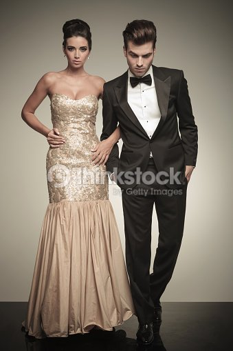full body picture of a elegant couple walking ストックフォト