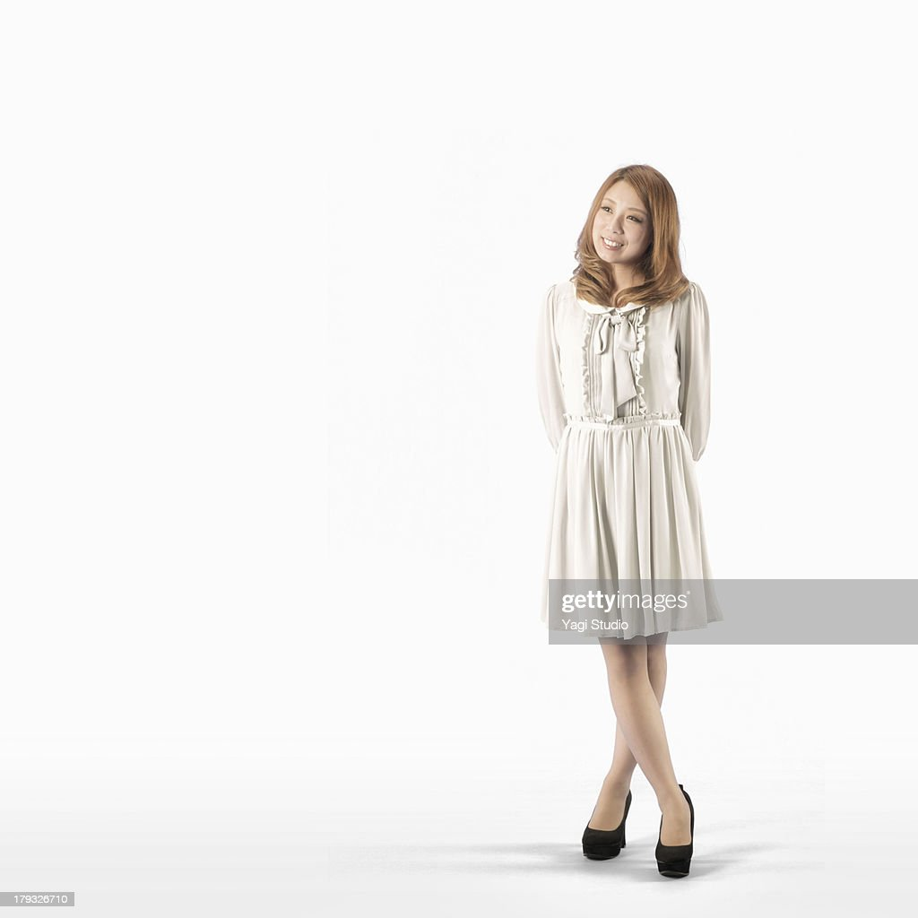 Full body shot of a woman,smiling : Stock Photo