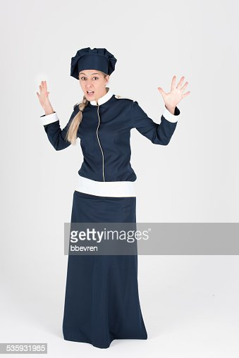 Full body shot of nice chef uniform in blue color : Stock Photo