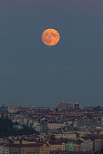 Full colored moon over night city