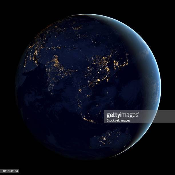 Full Earth at night showing city lights of Asia and Australia.