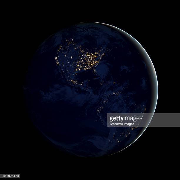 Full Earth at night showing city lights of the Americas.