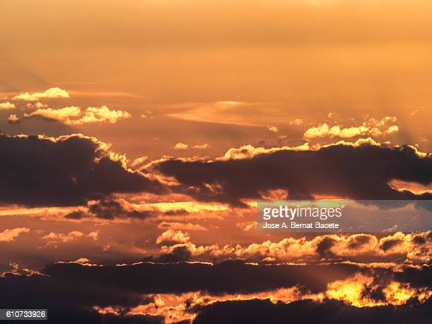 Full frame of a beautiful colorful orange sky with clouds at sunset