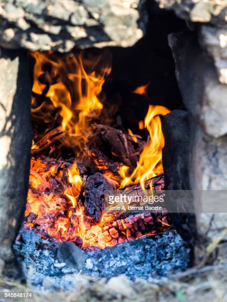 Full frame of an agricultural oven to warm water in the production of you them happen from one Muscatel,  people of Benicolet, Valencian Community, Spain.