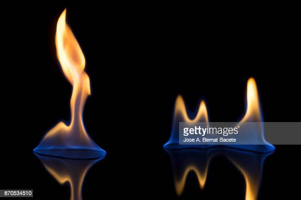 Full frame of flames and natural fire, on a black background,