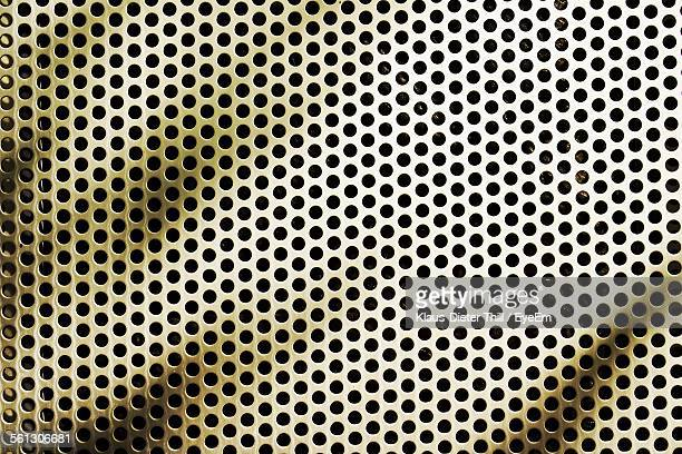 Full Frame Of Holes In Metal Grate
