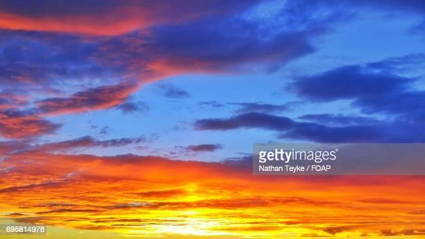 Full frame of orange clouds during sunset