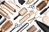 Full frame of professional hair dresser tools on white background