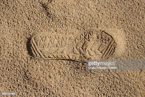 Full Frame Of Shoe Print On Sand