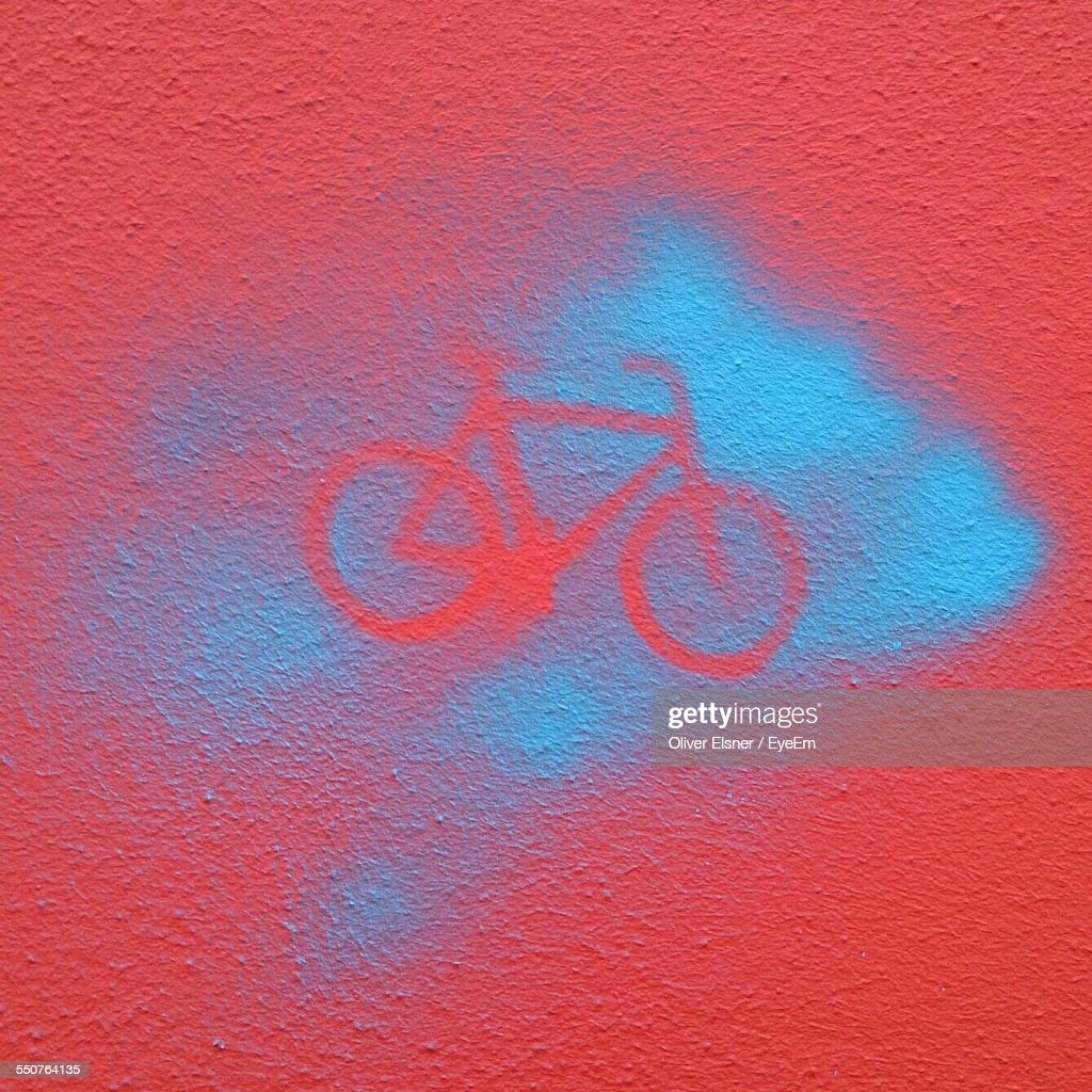 Full Frame Of Spray Painting Bicycle On Wall