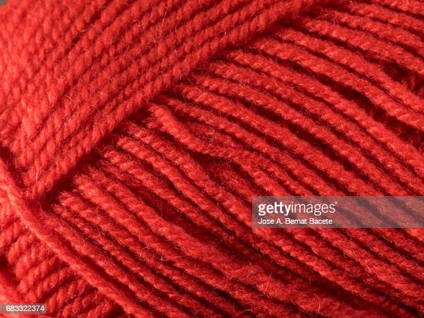 Full Frame of the threads of a skein of red wool