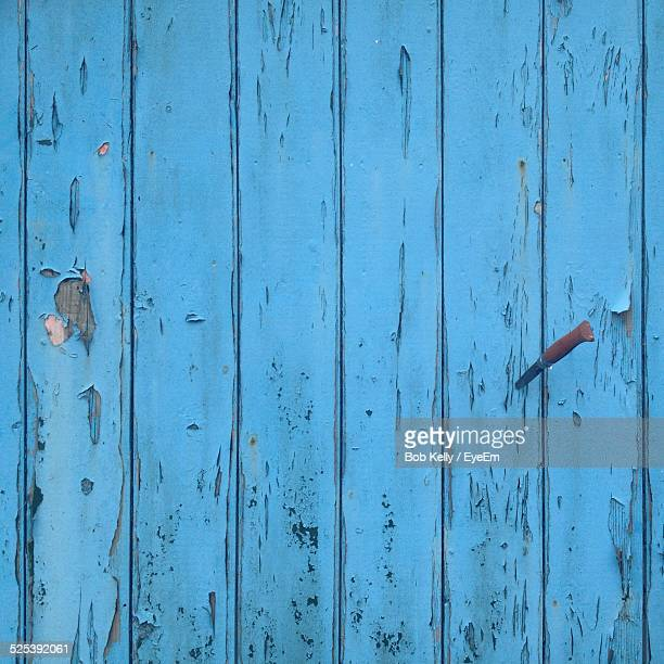 Full Frame Shot of Blue Wooden Plank With Knife On It