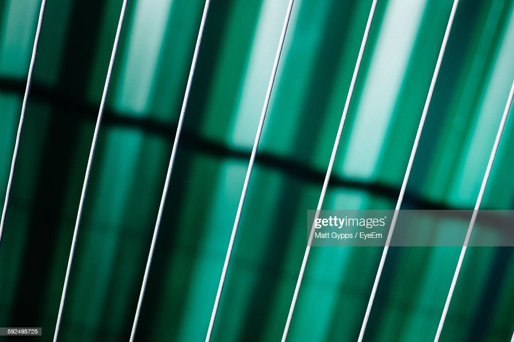 Full Frame Shot Of Cables In Front Of Fence Against Abstract Background