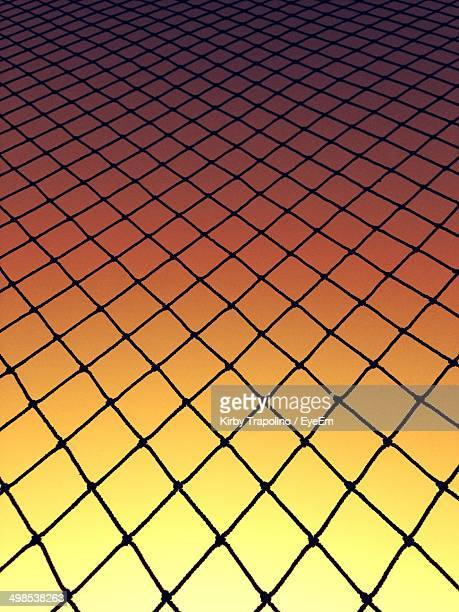 Full frame shot of chainlink fence against clear sky