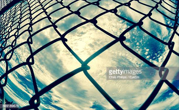 Full frame shot of chainlink fence against sky