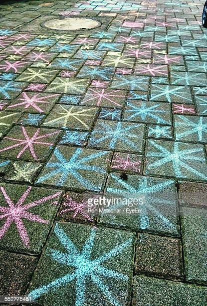 Full Frame Shot Of Chalk Drawing On Paving Stone Street