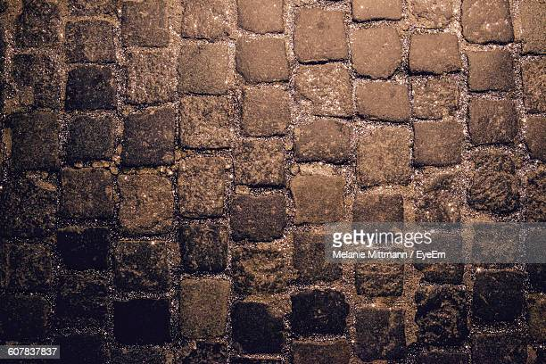 Full Frame Shot Of Cobblestone Footpath