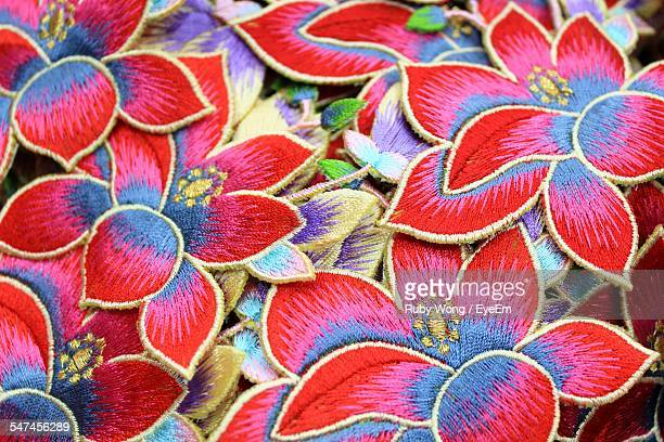 Full Frame Shot Of Colorful Floral Craft Products For Sale In Market