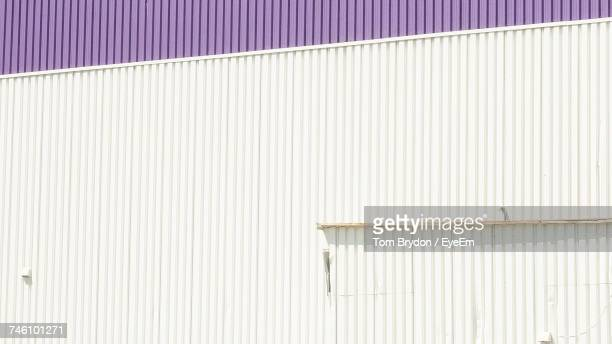 Full Frame Shot Of Corrugated Factory Wall During Sunny Day