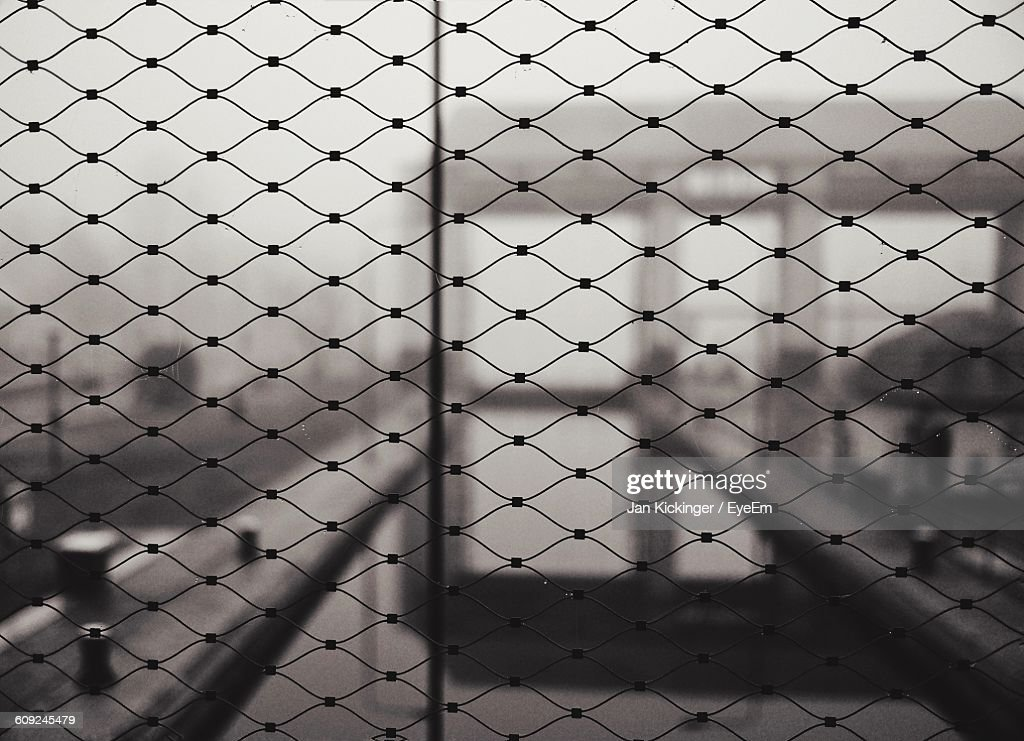 Full Frame Shot Of Fence By Canal During Foggy Weather
