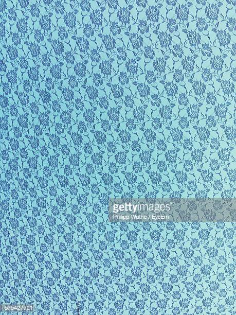 Full Frame Shot Of Floral Pattern On Blue Fabric
