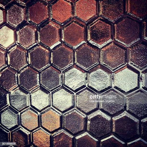 Full frame shot of glass with hexagon pattern