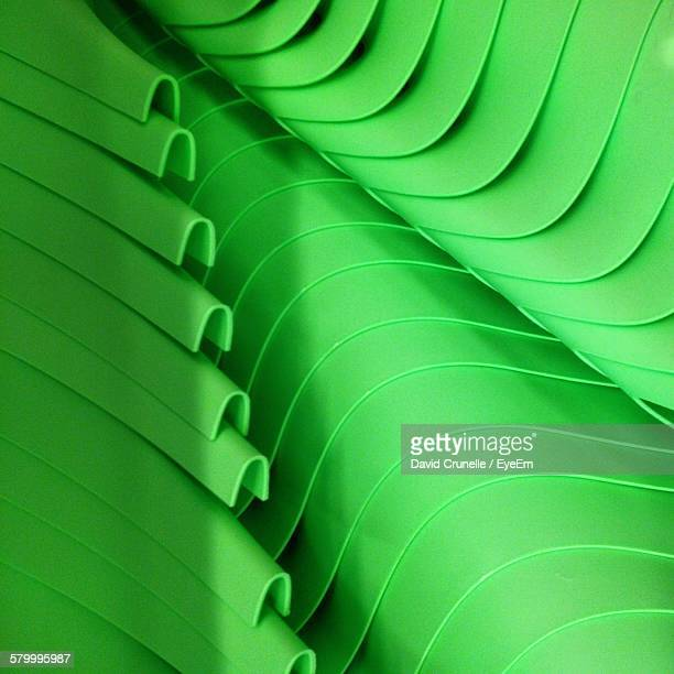 Full Frame Shot Of Green Stacked Chairs