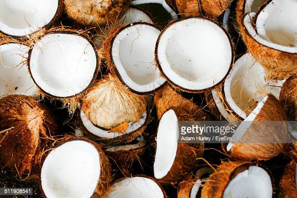 Full frame shot of halved coconuts